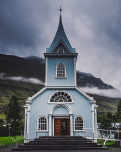blue and white wooden church during daytime